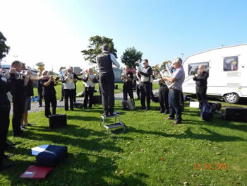 National Finals 2016, the band warming up in the sun at the Caravan Club at the racecourse